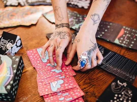 Mary Evans presents a tarot reading in her Joshua Tree home.