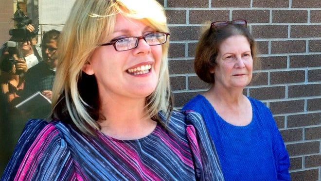 Kristine Bunch, left, with her mother Susan Hubbard, right, talks to reporters after she was released on Aug. 22, 2012. She was wrongfully convicted in the 1996 arson death of her 3-year-old son.