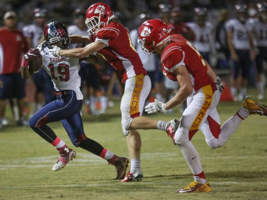 Derrick Kennedy of La Quinta is facemasked by Palm Desert late in the game, October 21, 2016.