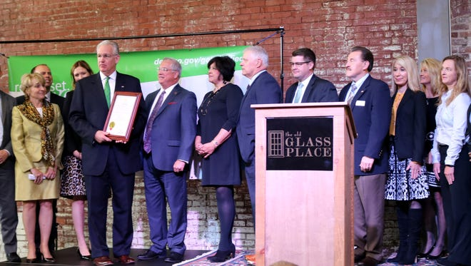 Governor Jay Nixon presents Greene County leaders the American College Testing appointed Certified Work Ready Community status.