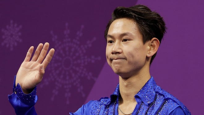 FILE - In this Feb. 16, 2018 file photo, figure skater Denis Ten, of Kazakhstan, reacts as his score is posted following his performance in the men's short program figure skating, in the Gangneung Ice Arena at the 2018 Winter Olympics in Gangneung, South Korea. Prosecutors in Kazakhstan said Thursday, July 19, 2018, that Olympic figure skating medalist Denis Ten has been killed, and they are treating the case as murder.  (AP Photo/David J. Phillip, File)