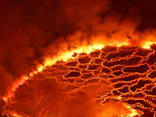 In this March 31, 2010 photo, magma churns and gushes