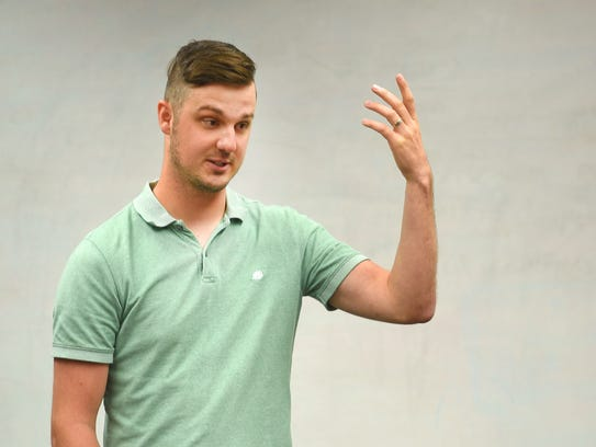 Adam Learing gives a presentation about his business,