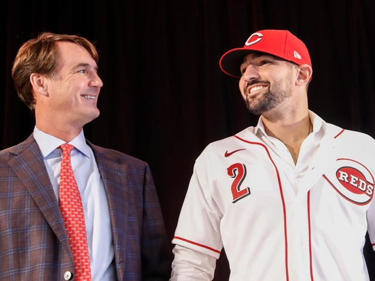 Cincinnati Reds 'Nick Castellanos, right, wears his jersey alongside Reds president and director of operations Dick Williams during a news conference, Tuesday, Jan. 28, 2020, in Cincinnati. Castellanos signed a $64 million, four-year deal with the baseball club. (AP Photo/John Minchillo)