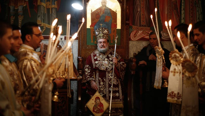 An Orthodox Christian priest heads the celebration  of Christmas at St. Porphyrius church in Gaza on Jan. 7, 2015.