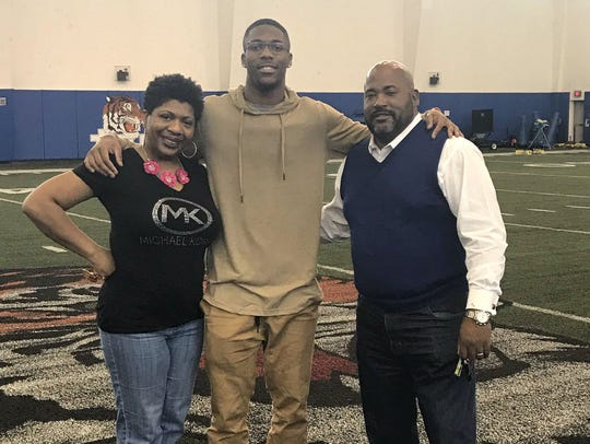 Former Minnesota quarterback Demry Croft, and his mother,