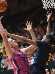 Oregon State center Marie Gulich (21) shoots despite defense from California center/forward Kristine Anigwe (31) during an NCAA college basketball game Sunday, Feb. 4, 2018, in Corvallis, Ore. (Amanda Loman/Albany Democrat-Herald via AP)