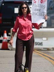 Lillian Hernandez, of Riverside, protest California