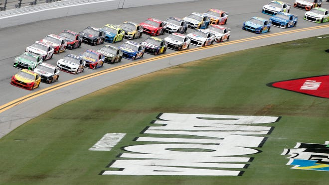 NASCAR Cup Series stock cars in action during the 2019 Coke Zero Sugar 400 at Daytona International Speedway.