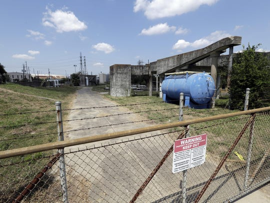 A gate at the U.S. Oil Recovery Superfund site is shown Thursday, Sept. 14, 2017, in Pasadena, Texas, where three tanks once used to store toxic waste were flooded during Hurricane Harvey. The Environmental Protection Agency says it has found no evidence that toxins washed off the site, but is still assessing damage.