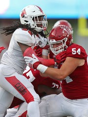 Ball State Cardinals defensive end Anthony Winbush (98) fights off Indiana Hoosiers offensive lineman Coy Cronk (54) during fourth quarter action at Indiana University's Memorial Stadium, Bloomington, Ind., Saturday, September 10, 2016. The Hoosiers beat the Cardinals, 30-20.