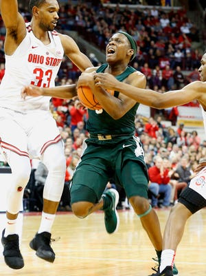 Michigan State guard Cassius Winston (5) goes in as Ohio State forward Keita Bates-Diop (33) and guard C.J. Jackson (3) defend during the second half of MSU's 80-64 loss on Sunday, Jan. 7, 2018, in Columbus, Ohio.