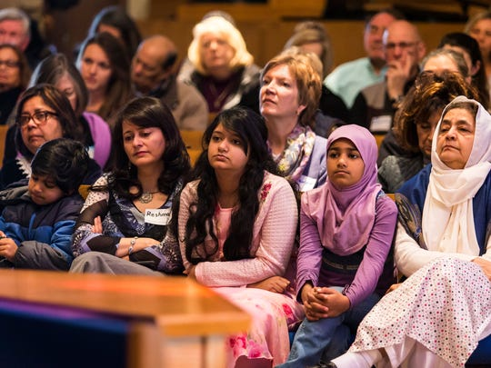 Audience members listen as Timmie Mirza, a CPA at the University of Delaware, speaks at a panel discussion on Islamophobia in America at Silverside Church in Brandywine Hundred on Sunday afternoon.