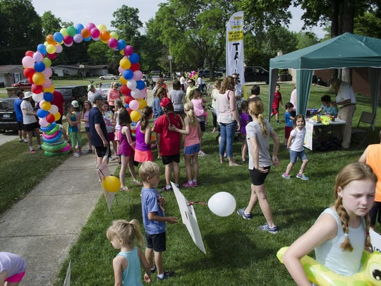 A crowd begins to gather on Grosse Ile for the first-ever Kids Fun Run for Paws organized by second-grader Sarah Shamus as a benefit for the Grosse Ile Animal Shelter.