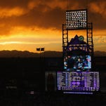 DENVER, CO - MAY 05:  Sunset falls over the stadium as the Atlanta Braves face the Colorado Rockies at Coors Field on May 5, 2012 in Denver, Colorado.