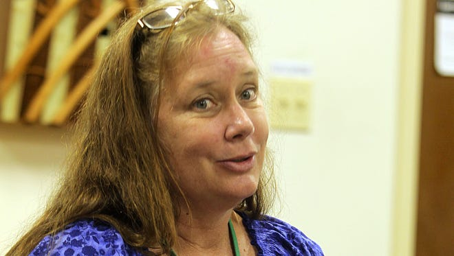Local grief counselor Pam Mezzina speaks during a meeting.