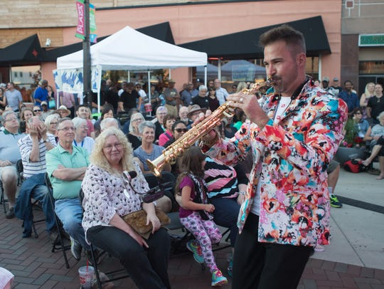 Saxophonist Phil Denny performs at the 2017 Summer