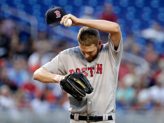 Boston Red Sox starting pitcher Chris Sale takes off his cap while pitching in the fourth inning of a baseball game against the Miami Marlins, Tuesday, April 3, 2018, in Miami. (AP Photo/Lynne Sladky)