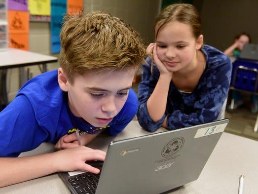 Rocky McKenzie codes while classmate Elizabeth Jensen