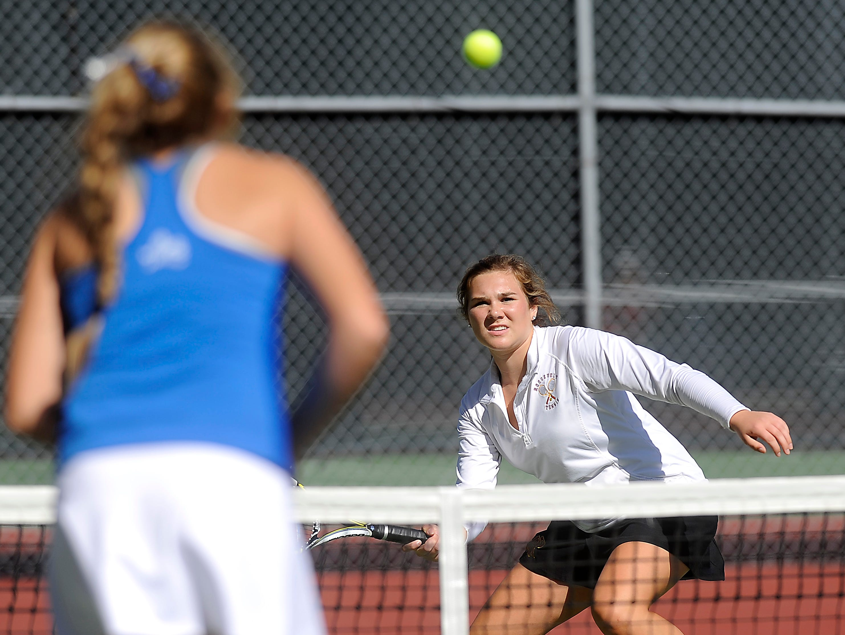 Roosevelt's Morgan Johnson returns the ball to Rapid City Stevens' Tianna Duba during doubles third round championship of the SD high school girls state tournament at McKennan Park in Sioux Falls, SD; Friday, Oct. 9, 2015.
