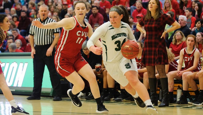 St. Johnsbury's Josie Choiniere (34) drives to the hoop past CVU's Meghan Gilwee (11) during the Vermont high school girls division I basketball championship between the St. Johnsbury Hilltoppers and the Champlain Valley Union Redhawks at Patrick Gym on Sunday afternoon March 11, 2018 in Burlington.