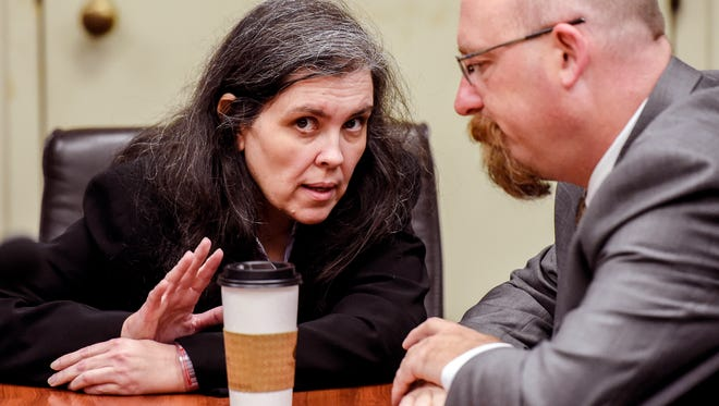 Louise Turpin, left, talks with her attorney Jeff Moore before a hearing at the Riverside Hall of Justice in this file photo.