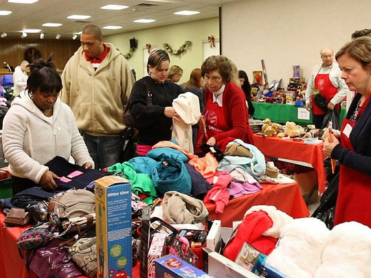 """The Salvation Army is distributing Christmas gifts for over 1400 children at the Toms River facility this week. At the """"Toy Shop"""" , volunteers help parents pick out gifts for their children. —December 22, 2015-Toms River, NJ.-Staff photographer/Bob Bielk/Asbury Park Press"""