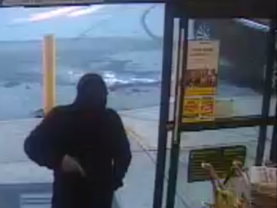 The photo seen here was taken during an armed robbery