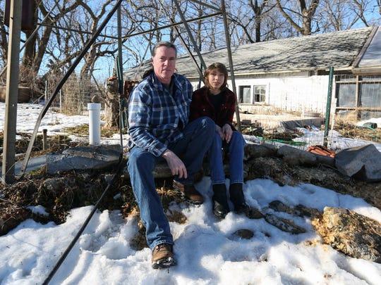 Joe Monahan sits near a well on his rural Boone property