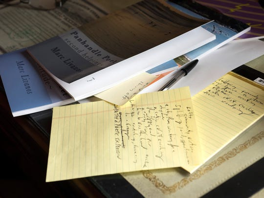 The desk of poet Marc Livanos is pictured on Tuesday,
