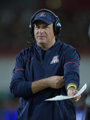 Arizona Wildcats head coach Rich Rodriguez reacts during