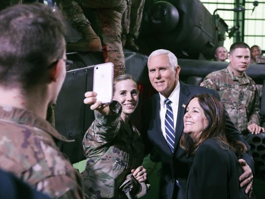 A U.S. soldier takes a selfie with Vice President Mike Pence and his wife, Karen, during a meeting with soldiers in Poland.