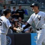 New York Yankees' Greg Bird, right, celebrates with John Ryan Murphy after Bird hit a three-run home run during the seventh inning of a baseball game against the Baltimore Orioles, Monday, Sept. 7, 2015, in New York. (AP Photo/Bill Kostroun)