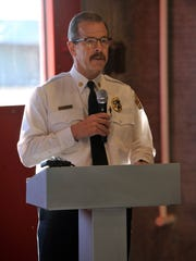 Abilene Fire Chief Randy Bell addresses the audience