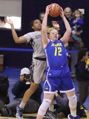 Delaware's Lizzie Oleary snags a rebound in front of Georgetown's Cynthia Petke in the second half of Delaware's 67-57 loss in a first round WNIT game at Georgetown's McDonough Arena.