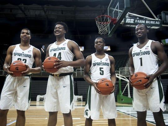 From left, Miles Bridges, Nick Ward, Cassius Winston