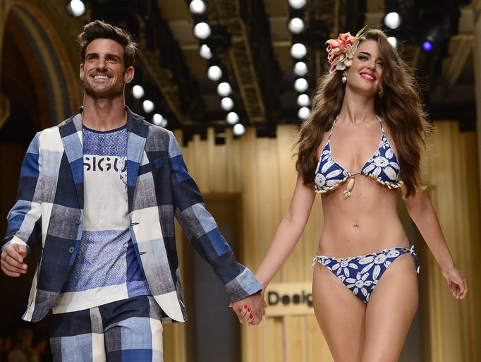 Models present creations by Desigual during the 080 Barcelona Spring-Summer 2015 fashion week in Barcelona on July 1, 2014.  AFP PHOTO/ JOSEP LAGO        (Photo credit should read JOSEP LAGO/AFP/Getty Images)