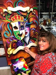 Andrea Mistretta at work on one of her posters. The