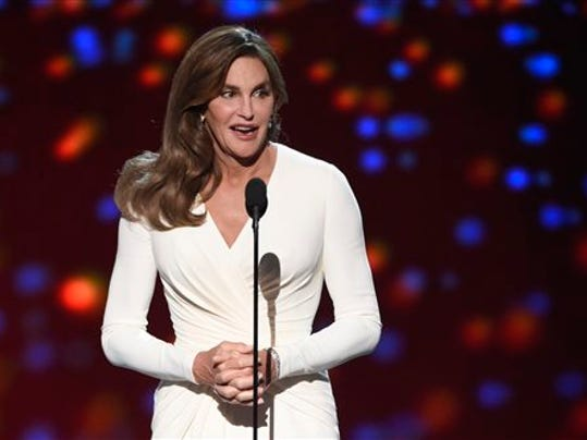 FILE - In this July 15, 2015 file photo, Caitlyn Jenner accepts the Arthur Ashe award for courage at the ESPY Awards at the Microsoft Theater, in Los Angeles. Prosecutors said Wednesday, Sept. 30, they have declined to charge Caitlyn Jenner in the Feb. 7 collision in California in which authorities said Jenner's sport utility vehicle crashed into two cars, pushing one into oncoming traffic. (Photo by Chris Pizzello/Invision/AP, File)