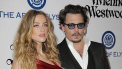 According to reports, Amber Heard has filed for divorce