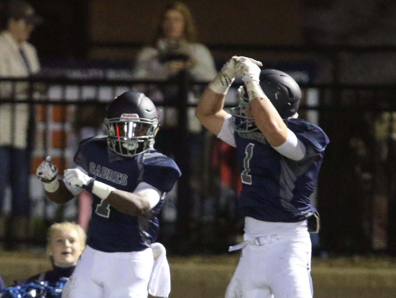 Southside Christian School's Quintyn Reeder(7) and Southside Christian School's Josh Tolbert(1) celebrate a touchdown. Southside Christian School hosted Williston-Elko High for the second round of the 1-A Playoffs.