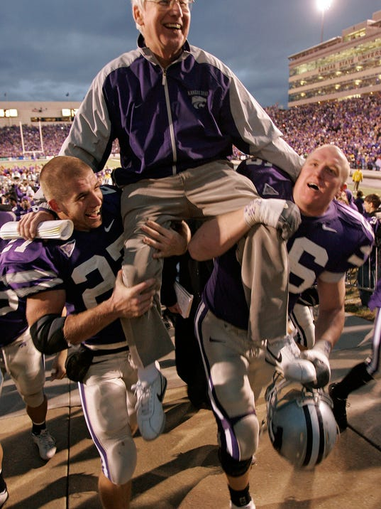 FILE - In this Nov. 19, 2005, file photo, Kansas State coach Bill Snyder is carried off the field by Jordy Nelson, left, and Jeremy Clary after defeating Missouri 36-28, in Manhattan, Kan. Snyder tried the retirement route in 2005 and it lasted three years. He simply couldn't stay away. (Jim Barcus/The Kansas City Star via AP, File)