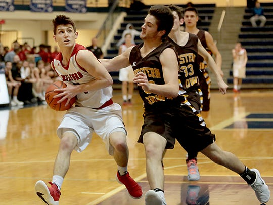 Milford guard Jake Ayler moves to the basket against