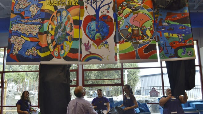 ImagineU Children's Museum unveils the 5-panel international mural project, Wednesday afternoon at the museum. The project was unveiled in honor of United Nations International Peace Day.