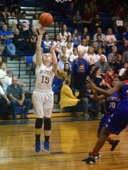 Buckeye's Gracee Bryant (15) attempts a layup against