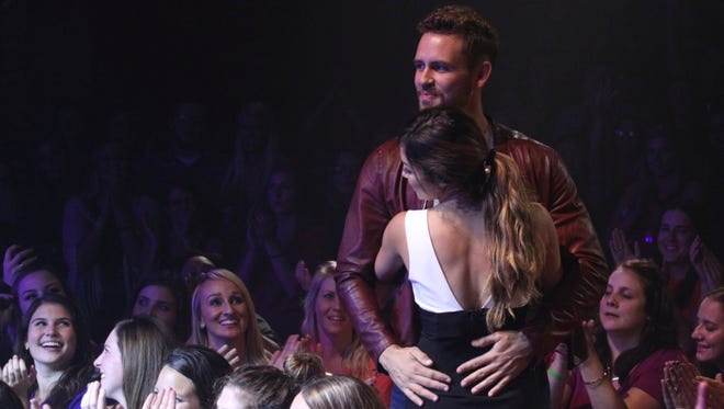 Nick Viall and Danielle L. dance on stage at the Pabst Theater during a one-on-one date.