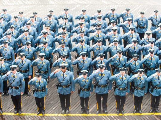 New Jersey State Troopers take one final moment to