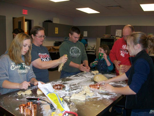 Rozellville Rockets 4-H Club members make cookies for a fundraiser.