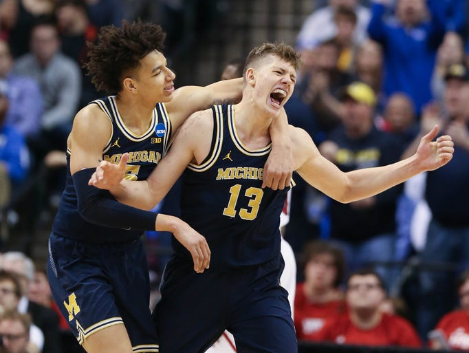 Michigan Wolverines forwards Moe Wagner, right, and