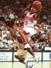 Clemson's Terrell McIntyre (5) drives past Georgia Tech's T.J. Vines (10) for a basket at Littlejohn Coliseum during the 1999 season.